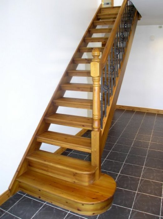 Red Deal Stairs with Oak Stain and Wrought Iron