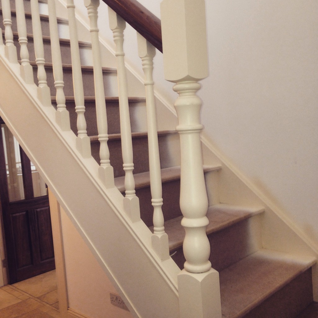 Beautiful White Stairs With Walnut Handrail