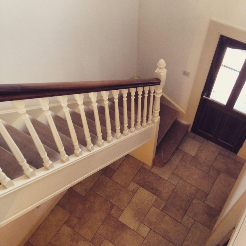 White stairs with walnut handrail